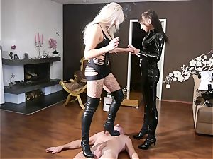 German domina penalizes a victim with stomping his shaft