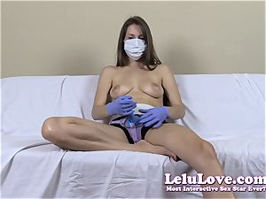 braless girl with medical mask and strapon