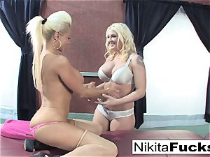 Nikita gets a loosening massage from Leya