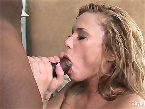 Shyla Stylez gets her vag fucked by a giant ebony hard-on