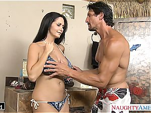 Ava Addams places his cock inbetween her yam-sized fun bags