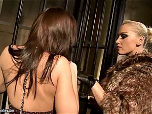 Kathia Nobili in furry jacket tantalizing a super-fucking-hot babe