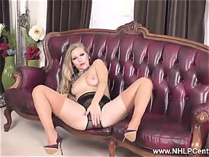 platinum-blonde strips off lingerie and solos in nylons and high-heeled shoes