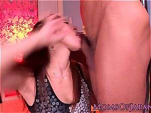 chinese mama grinds her vulva on his face