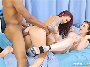 Monique Alexander and Ivy Lebelle railing the medic