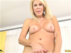 Mature ash-blonde showcases off her gash and pummels