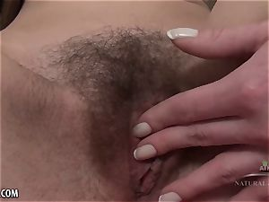 scorching long haired hottie gropes her hairy labia