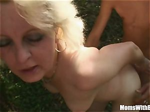 light-haired Mama Jana Receives tough drilling Outdoors